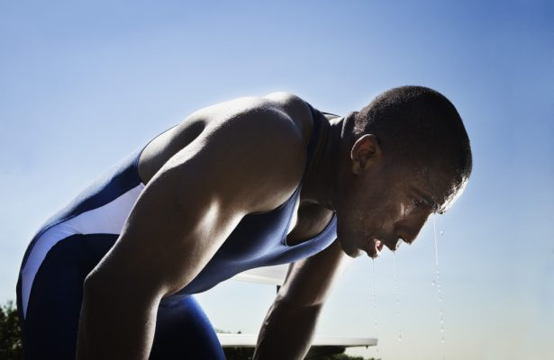 Athletic man resting after race